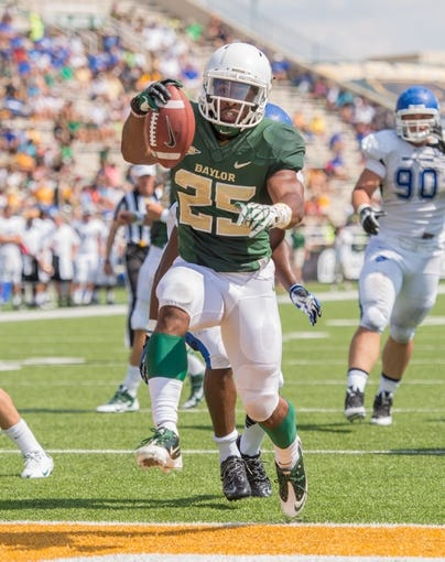 Sep 7, 2013; Waco, TX, USA; Baylor Bears running back Lache Seastrunk (25) runs for a touchdown against the Buffalo Bulls during the game at Floyd Casey Stadium. The Bears defeated the Bulls 70-13. Mandatory Credit: Jerome Miron-USA TODAY Sports