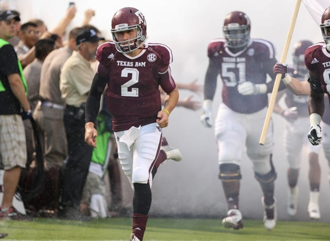Sep 7, 2013; College Station, TX, USA; Texas A&M Aggies quarterback Johnny Manziel (2) runs onto the field before a game against the Sam Houston State Bearkats at Kyle Field. Mandatory Credit: Troy Taormina-USA TODAY Sports