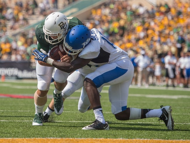 Sep 7, 2013; Waco, TX, USA; Buffalo Bulls defensive back Witney Sherry (10) tries to bring down Baylor Bears quarterback Bryce Petty (14) during the game at Floyd Casey Stadium. The Bears defeated the Bulls 70-13. Mandatory Credit: Jerome Miron-USA TODAY Sports