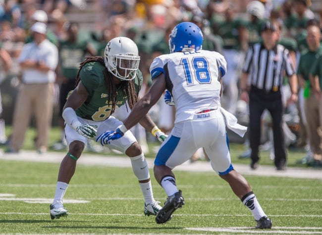 Sep 7, 2013; Waco, TX, USA; Baylor Bears cornerback K.J. Morton (8) covers Buffalo Bulls wide receiver Fred Lee (18) during the game at Floyd Casey Stadium. The Bears defeated the Bulls 70-13. Mandatory Credit: Jerome Miron-USA TODAY Sports