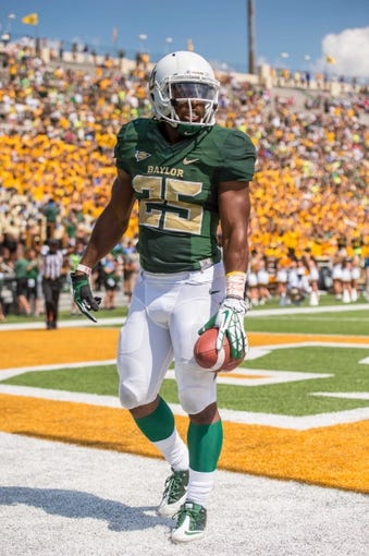 Sep 7, 2013; Waco, TX, USA; Baylor Bears running back Lache Seastrunk (25) celebrates his touchdown against the Buffalo Bulls during the game at Floyd Casey Stadium. The Bears defeated the Bulls 70-13. Mandatory Credit: Jerome Miron-USA TODAY Sports