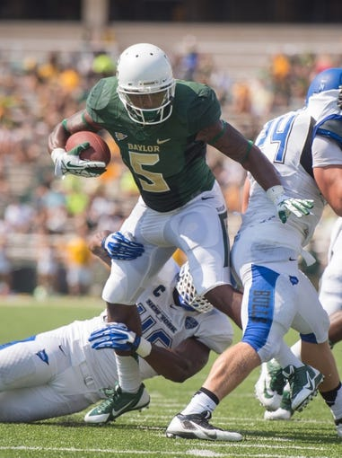 Sep 7, 2013; Waco, TX, USA; Baylor Bears wide receiver Antwan Goodley (5) is tackled by Buffalo Bulls linebacker Khalil Mack (46) during the game at Floyd Casey Stadium. The Bears defeated the Bulls 70-13. Mandatory Credit: Jerome Miron-USA TODAY Sports