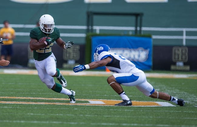 Sep 7, 2013; Waco, TX, USA; Baylor Bears running back Lache Seastrunk (25) eludes Buffalo Bulls defensive back Adam Redden (29) during the game at Floyd Casey Stadium. The Bears defeated the Bulls 70-13. Mandatory Credit: Jerome Miron-USA TODAY Sports