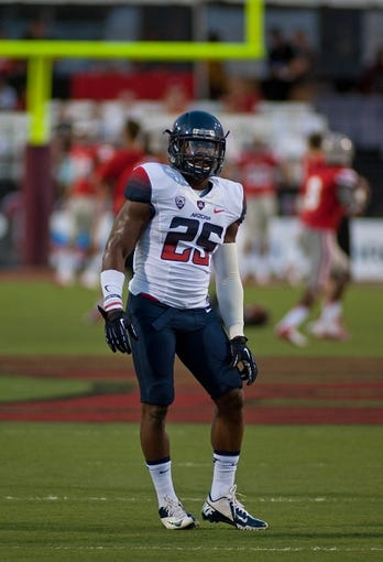 Sep 7, 2013; Las Vegas, NV, USA; Arizona Wildcats running back Ka'Deem Carey participates in warm up drills before the start of an NCAA football game against the UNLV Rebels at Sam Boyd Stadium. Mandatory Credit: Stephen R. Sylvanie-USA TODAY Sports