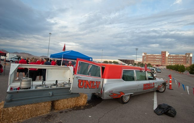 Sep 7, 2013; Las Vegas, NV, USA; A 1970 Cadillac converted into a tailgating hearse with a keg-filled coffin greets football fans near the entrance to Sam Boyd Stadium as the UNLV Rebels host the Arizona Wildcats for their home opener in Las Vegas. Mandatory Credit: Stephen R. Sylvanie-USA TODAY Sports