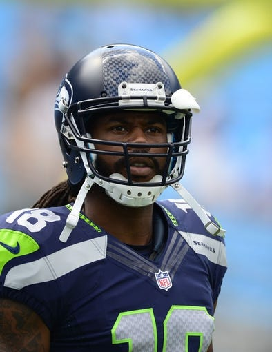 Sep 8, 2013; Charlotte, NC, USA; Seattle Seahawks wide receiver Sidney Rice (18) on the field before the game. The Seahawks defeated the Panthers 12-7 at Bank of America Stadium. Mandatory Credit: Bob Donnan-USA TODAY Sports