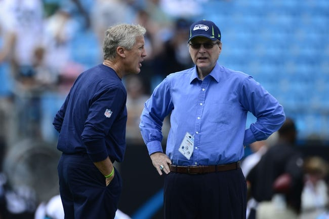 Sep 8, 2013; Charlotte, NC, USA; Seattle Seahawks head coach Pete Carroll (left) and owner Paul Allen on the field before the game. The Seahawks defeated the Panthers 12-7 at Bank of America Stadium. Mandatory Credit: Bob Donnan-USA TODAY Sports