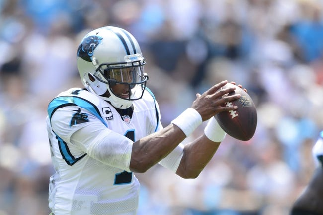 Sep 8, 2013; Charlotte, NC, USA; Carolina Panthers quarterback Cam Newton (1) with the ball in the first quarter. The Seahawks defeated the Panthers 12-7 at Bank of America Stadium. Mandatory Credit: Bob Donnan-USA TODAY Sports