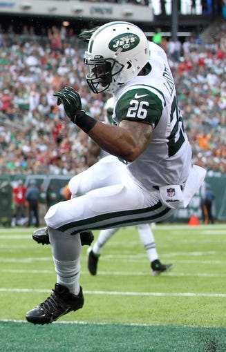 Sep 8, 2013; East Rutherford, NJ, USA; New York Jets safety Dawan Landry (26) during the first quarter of a game at MetLife Stadium. Mandatory Credit: Brad Penner-USA TODAY Sports