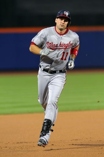 Sep 9, 2013; New York, NY, USA; Washington Nationals third baseman Ryan Zimmerman (11) rounds the bases after hitting a home run against the New York Mets during the first inning of a game at Citi Field. Mandatory Credit: Brad Penner-USA TODAY Sports