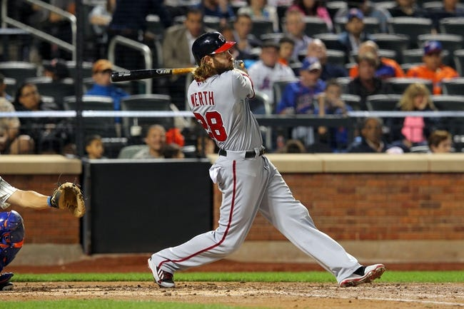 Sep 9, 2013; New York, NY, USA; Washington Nationals right fielder Jayson Werth (28) hits a three-run home run against the New York Mets during the third inning of a game at Citi Field. Mandatory Credit: Brad Penner-USA TODAY Sports