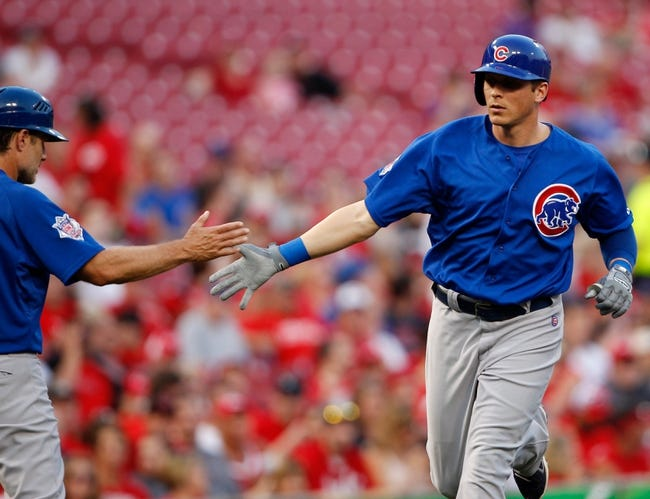 Sep 9, 2013; Cincinnati, OH, USA; Chicago Cubs center fielder Ryan Sweeney (6) is congratulated by third base coach David Bell (3) after hitting a home run during the second inning against the Cincinnati Reds at Great American Ball Park. Mandatory Credit: Frank Victores-USA TODAY Sports
