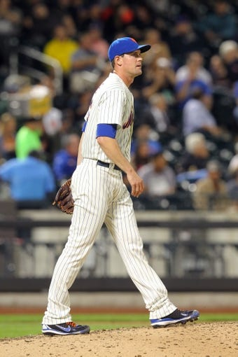 Sep 9, 2013; New York, NY, USA; New York Mets relief pitcher Greg Burke (46) reacts after allowing a three-run home run to Washington Nationals catcher Wilson Ramos (not pictured) during the fifth inning of a game at Citi Field. Mandatory Credit: Brad Penner-USA TODAY Sports