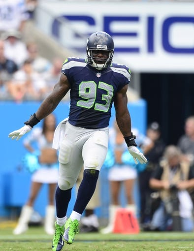 Sep 8, 2013; Charlotte, NC, USA; Seattle Seahawks linebacker O'Brien Schofield (93) reacts in the first quarter. The Seahawks defeated the Panthers 12-7 at Bank of America Stadium. Mandatory Credit: Bob Donnan-USA TODAY Sports