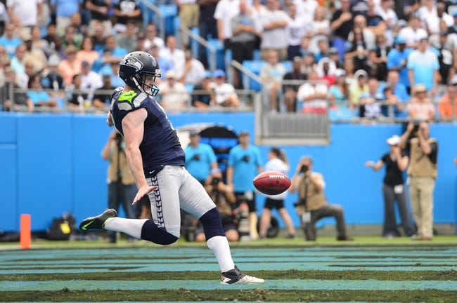 Sep 8, 2013; Charlotte, NC, USA; Seattle Seahawks punter Jon Ryan (9) punts in the first quarter. The Seahawks defeated the Panthers 12-7 at Bank of America Stadium. Mandatory Credit: Bob Donnan-USA TODAY Sports