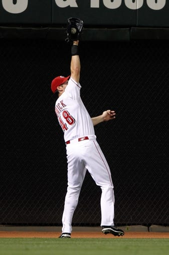 Sep 9, 2013; Cincinnati, OH, USA; Cincinnati Reds left fielder Ryan Ludwick (48) makes a catch during the eighth inning against the Chicago Cubs at Great American Ball Park. The Cubs defeated the Reds 2-0. Mandatory Credit: Frank Victores-USA TODAY Sports