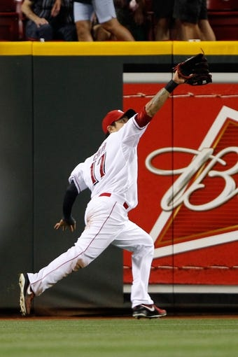 Sep 9, 2013; Cincinnati, OH, USA; Cincinnati Reds center fielder Shin-Soo Choo (17) makes a catch during the ninth inning against the Chicago Cubs at Great American Ball Park. The Cubs defeated the Reds 2-0. Mandatory Credit: Frank Victores-USA TODAY Sports