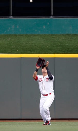Sep 9, 2013; Cincinnati, OH, USA; Cincinnati Reds center fielder Shin-Soo Choo (17) makes a catch during the first inning against the Chicago Cubs at Great American Ball Park. Mandatory Credit: Frank Victores-USA TODAY Sports