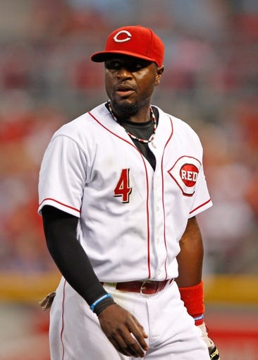 Sep 9, 2013; Cincinnati, OH, USA; Cincinnati Reds second baseman Brandon Phillips (4) walks off of the field during the third inning against the Chicago Cubs at Great American Ball Park. Mandatory Credit: Frank Victores-USA TODAY Sports