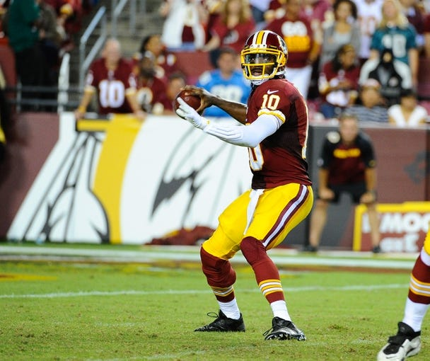 Sep 9, 2013; Landover, MD, USA; Washington Redskins quarterback Robert Griffin III (10) throws a pass against the Philadelphia Eagles during the second half at FedEX Field. The Eagles won 33 - 27. Mandatory Credit: Brad Mills-USA TODAY Sports