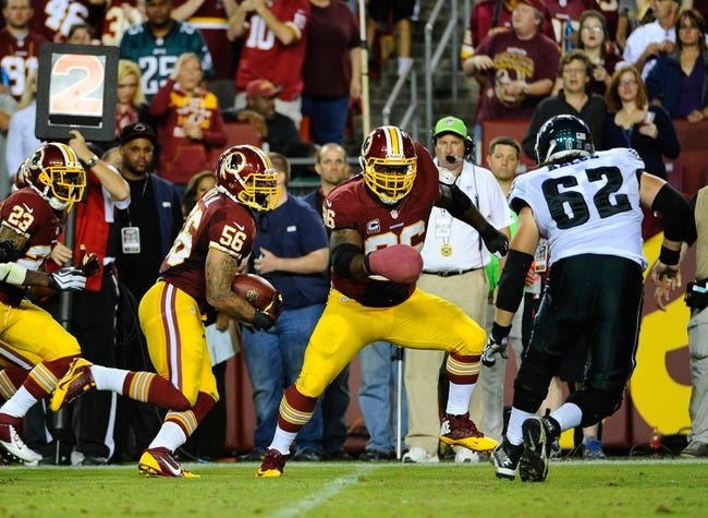 Sep 9, 2013; Landover, MD, USA; Washington Redskins linebacker Perry Riley (56) runs with the ball after recovering a fumble during the second half at FedEX Field. The Eagles won 33 - 27. Mandatory Credit: Brad Mills-USA TODAY Sports