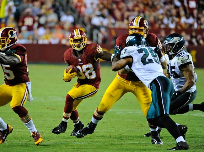 Sep 9, 2013; Landover, MD, USA; Washington Redskins wide receiver Pierre Garcon (88) runs with the ball against the Philadelphia Eagles during the second half at FedEX Field. The Eagles won 33 - 27. Mandatory Credit: Brad Mills-USA TODAY Sports