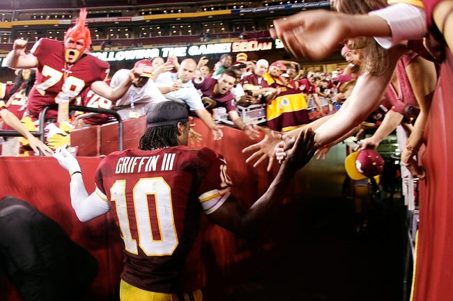 Sep 9, 2013; Landover, MD, USA; Washington Redskins quarterback Robert Griffin III (10) walks off the field after the Redskins game against the Philadelphia Eagles at FedEx Field. The Eagles won 33-27. Mandatory Credit: Geoff Burke-USA TODAY Sports