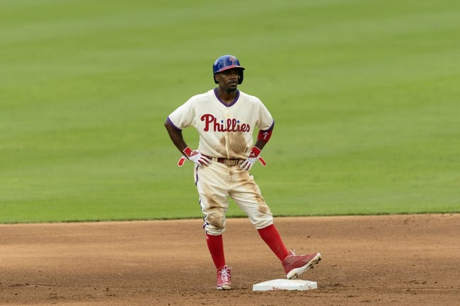 Sep 8, 2013; Philadelphia, PA, USA; Philadelphia Phillies shortstop Jimmy Rollins (11) stands on second base during the fifth inning against the Atlanta Braves at Citizens Bank Park. The Phillies defeated the Braves 3-2. Mandatory Credit: Howard Smith-USA TODAY Sports