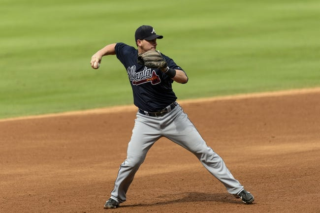 Sep 8, 2013; Philadelphia, PA, USA; Atlanta Braves third baseman Chris Johnson (23) throws to first base during the fifth inning against the Philadelphia Phillies at Citizens Bank Park. The Phillies defeated the Braves 3-2. Mandatory Credit: Howard Smith-USA TODAY Sports