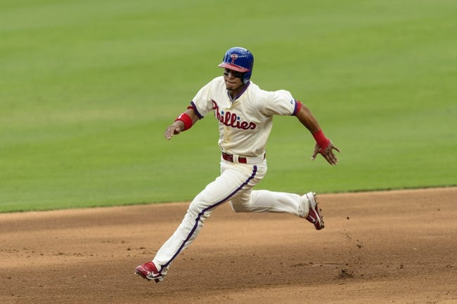 Sep 8, 2013; Philadelphia, PA, USA; Philadelphia Phillies center fielder Cesar Hernandez (16) attempts to advance from first to third base during the fifth inning against the Atlanta Braves at Citizens Bank Park. The Phillies defeated the Braves 3-2. Mandatory Credit: Howard Smith-USA TODAY Sports