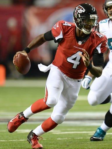 Aug 29, 2013; Atlanta, GA, USA; Atlanta Falcons quarterback Dominique Davis (4) during the first quarter at the Georgia Dome. Mandatory Credit: Dale Zanine-USA TODAY Sports