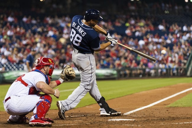 Sep 10, 2013; Philadelphia, PA, USA; San Diego Padres first baseman Kyle Blanks (88) singles during the fourth inning against the Philadelphia Phillies at Citizens Bank Park. Mandatory Credit: Howard Smith-USA TODAY Sports