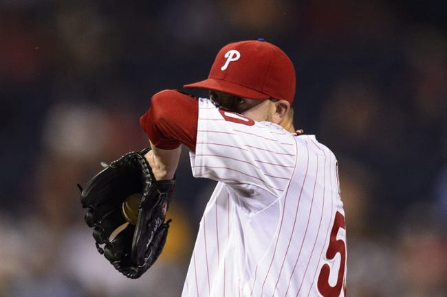Sep 10, 2013; Philadelphia, PA, USA; Philadelphia Phillies pitcher Tyler Cloyd (50) wipes the sweat from his face during the fourth inning against the San Diego Padres at Citizens Bank Park. Mandatory Credit: Howard Smith-USA TODAY Sports