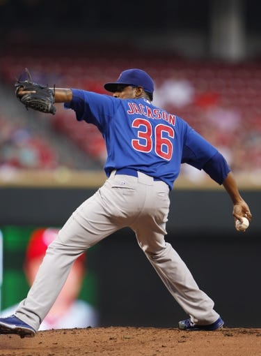 Sep 10, 2013; Cincinnati, OH, USA; Chicago Cubs starting pitcher Edwin Jackson (36) pitches during the first inning against the Cincinnati Reds at Great American Ball Park. Mandatory Credit: Frank Victores-USA TODAY Sports
