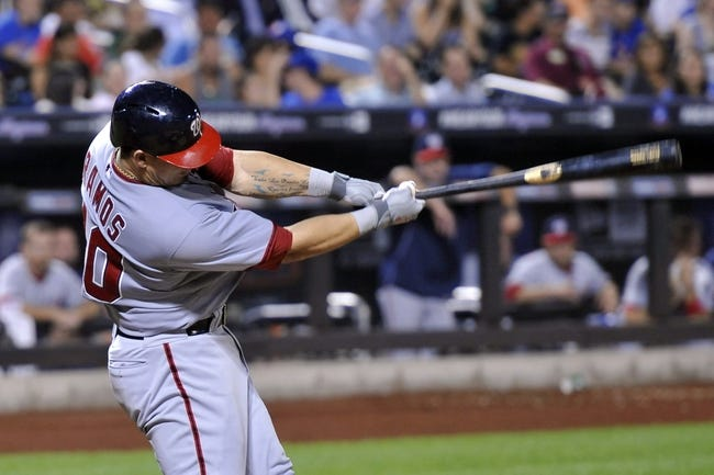 Sep 10, 2013; New York, NY, USA; Washington Nationals catcher Wilson Ramos (40) hits an RBI single during the sixth inning against the New York Mets at Citi Field. Mandatory Credit: Joe Camporeale-USA TODAY Sports
