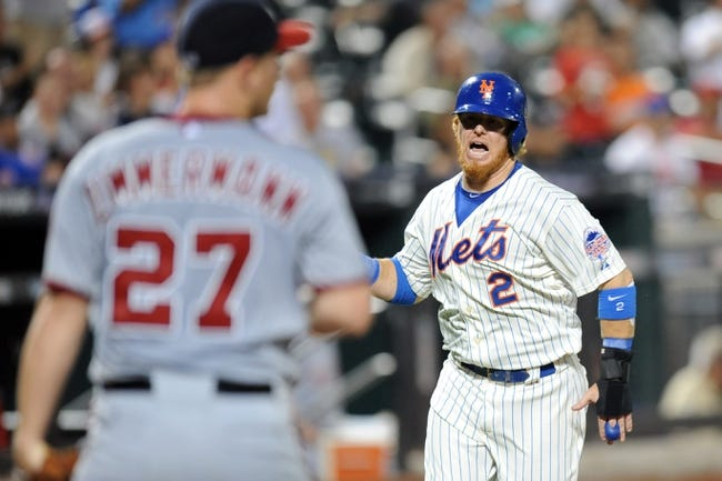 Sep 10, 2013; New York, NY, USA; New York Mets first baseman Justin Turner (2) scores a run during the sixth inning after being driven in by New York Mets center fielder Matt den Dekker (not pictured) during the sixth inning against the Washington Nationals at Citi Field. Mandatory Credit: Joe Camporeale-USA TODAY Sports