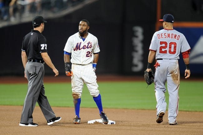 Sep 10, 2013; New York, NY, USA;New York Mets left fielder Eric Young Jr. (22) reacts after being tagged out during a steal attempt against the Washington Nationals in the seventh inning  at Citi Field. Mandatory Credit: Joe Camporeale-USA TODAY Sports