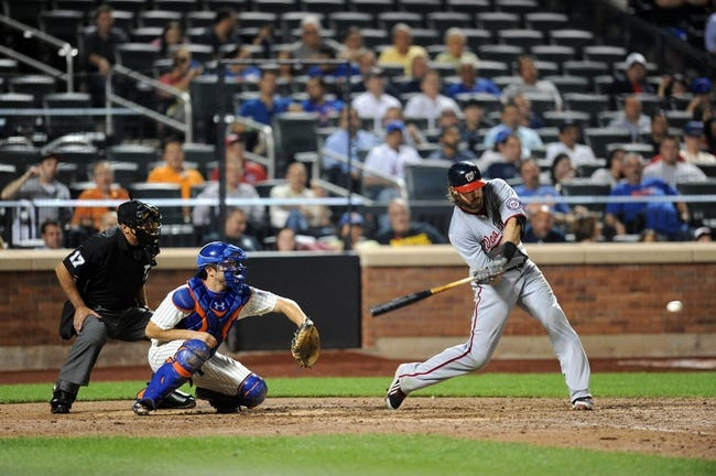 Sep 10, 2013; New York, NY, USA; Washington Nationals right fielder Jayson Werth (28) takes a swing at a pitch against the New York Mets during the eighth inning at Citi Field. Mandatory Credit: Joe Camporeale-USA TODAY Sports