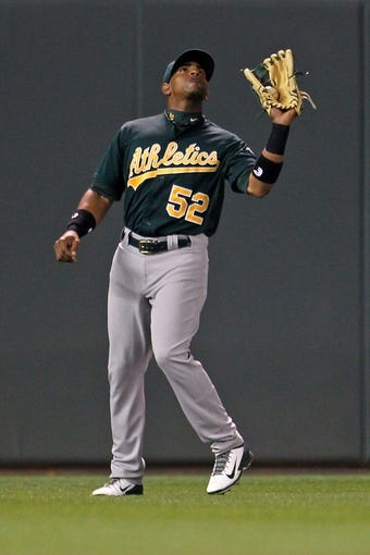Sep 10, 2013; Minneapolis, MN, USA; Oakland Athletics outfielder Yoenis Cespedes (52) catches a fly ball during the fourth inning against the Minnesota Twins at Target Field. Mandatory Credit: Brace Hemmelgarn-USA TODAY Sports