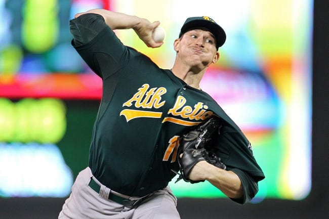 Sep 10, 2013; Minneapolis, MN, USA; Oakland Athletics pitcher Jarrod Parker (11) delivers a pitch during the first inning against the Minnesota Twins at Target Field. Mandatory Credit: Brace Hemmelgarn-USA TODAY Sports