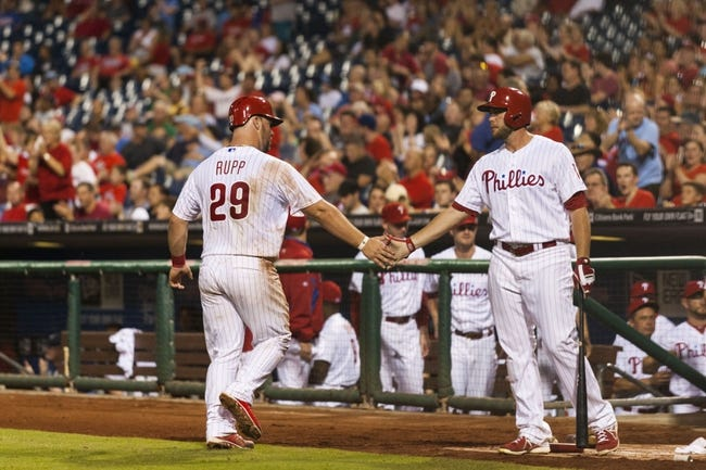 Sep 10, 2013; Philadelphia, PA, USA; Philadelphia Phillies catcher Cameron Rupp (29) celebrates scoring with right fielder Darin Ruf (18) during the eighth inning against the San Diego Padres at Citizens Bank Park. The Padres defeated the Phillies 8-2. Mandatory Credit: Howard Smith-USA TODAY Sports