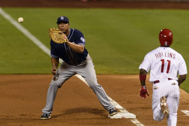Sep 10, 2013; Philadelphia, PA, USA; San Diego Padres first baseman Kyle Blanks (88) forces out Philadelphia Phillies shortstop Jimmy Rollins (11) during the fourth inning at Citizens Bank Park. The Padres defeated the Phillies 8-2. Mandatory Credit: Howard Smith-USA TODAY Sports