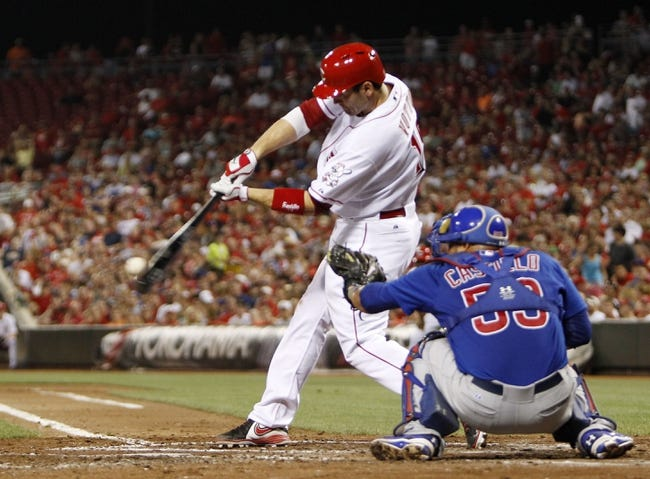Sep 10, 2013; Cincinnati, OH, USA; Cincinnati Reds first baseman Joey Votto (19) doubles during the third inning against the Chicago Cubs at Great American Ball Park. Mandatory Credit: Frank Victores-USA TODAY Sports