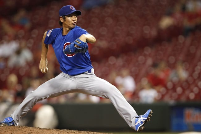 Sep 10, 2013; Cincinnati, OH, USA; Chicago Cubs relief pitcher Chang-Yong Lim (12) pitches during the eighth inning against the Cincinnati Reds at Great American Ball Park. The Cubs won 9-1. Mandatory Credit: Frank Victores-USA TODAY Sports