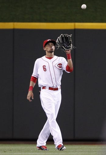 Sep 10, 2013; Cincinnati, OH, USA; Cincinnati Reds center fielder Billy Hamilton (6) makes a catch during the eighth inning against the Chicago Cubs at Great American Ball Park. The Cubs won 9-1. Mandatory Credit: Frank Victores-USA TODAY Sports