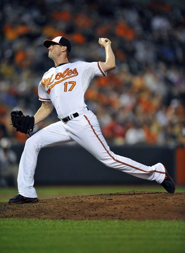 Sep 10, 2013; Baltimore, MD, USA; Baltimore Orioles pitcher Brian Matusz (17) throws in the ninth inning against the New York Yankees at Oriole Park at Camden Yards. The Yankees defeated the Orioles 7-5. Mandatory Credit: Joy R. Absalon-USA TODAY Sports