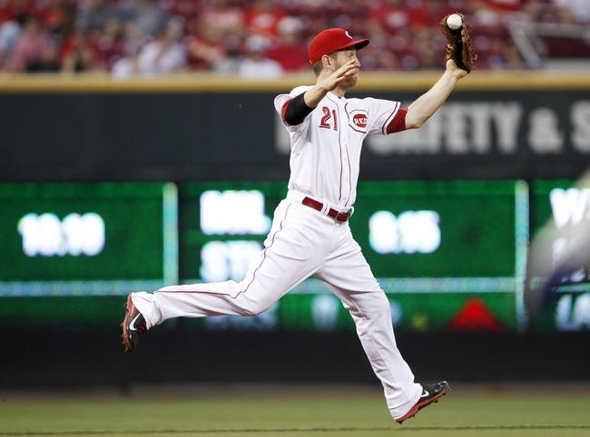 Sep 10, 2013; Cincinnati, OH, USA; Cincinnati Reds third baseman Todd Frazier (21) makes a play during the second inning against the Chicago Cubs at Great American Ball Park. Mandatory Credit: Frank Victores-USA TODAY Sports