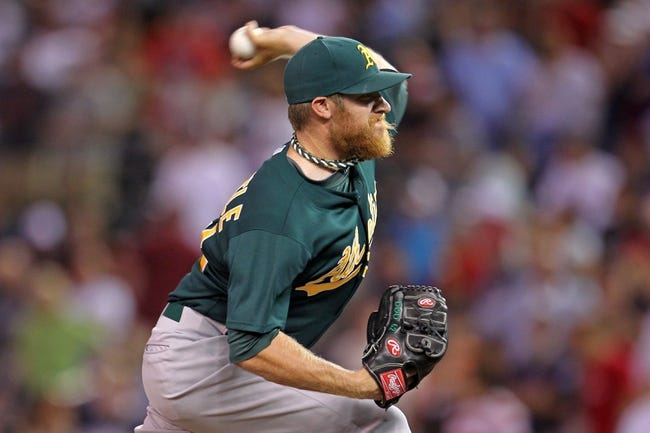 Sep 10, 2013; Minneapolis, MN, USA; Oakland Athletics pitcher Sean Doolittle (62) delivers a pitch during the seventh inning against the Minnesota Twins at Target Field. The Twins won 4-3. Mandatory Credit: Brace Hemmelgarn-USA TODAY Sports