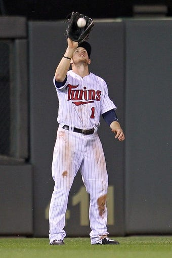 Sep 10, 2013; Minneapolis, MN, USA; Minnesota Twins outfielder Alex Presley (1) catches a fly ball during the eighth inning against the Oakland Athletics at Target Field. The Twins won 4-3. Mandatory Credit: Brace Hemmelgarn-USA TODAY Sports