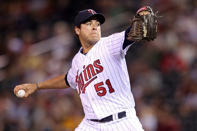 Sep 10, 2013; Minneapolis, MN, USA; Minnesota Twins pitcher Anthony Swarzak (51) delivers a pitch during the eighth inning against the Oakland Athletics at Target Field. The Twins won 4-3. Mandatory Credit: Brace Hemmelgarn-USA TODAY Sports